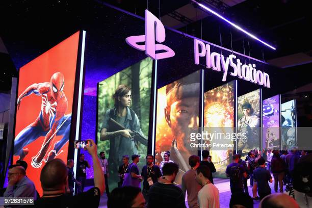 Game enthusiasts and industry personnel visit the 'Sony Playstation' exhibit during the Electronic Entertainment Expo E3 at the Los Angeles...