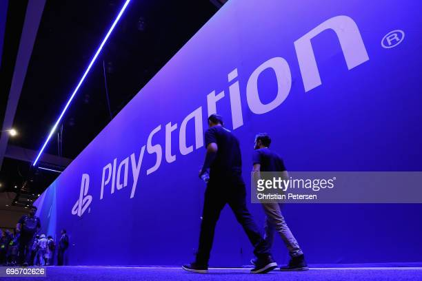Game enthusiasts and industry personnel walk past the 'Sony Playstation' exhibit during the Electronic Entertainment Expo E3 at the Los Angeles...