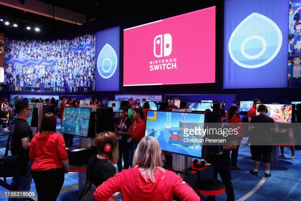 Game enthusiasts and industry visit the Nintendo exhibit during the E3 Video Game Convention at the Los Angeles Convention Center on June 11, 2019 in...