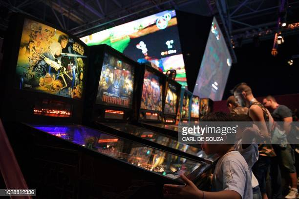 Game enthusiasts play with pinball machines during the Game XP event at the Olympic Park in Rio de Janeiro Brazil on September 7 2018 The four day...