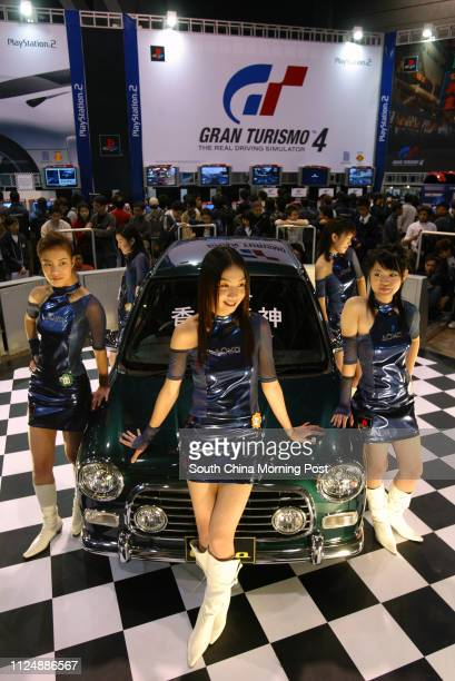 Game Girls present Mini Cooper the top prize of the Gran Turismo 4 game contest at the Asia Game Show at the Hong Kong Convention and Exhibition...