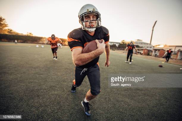nfl game in motion - guard american football player stock photos and pictures