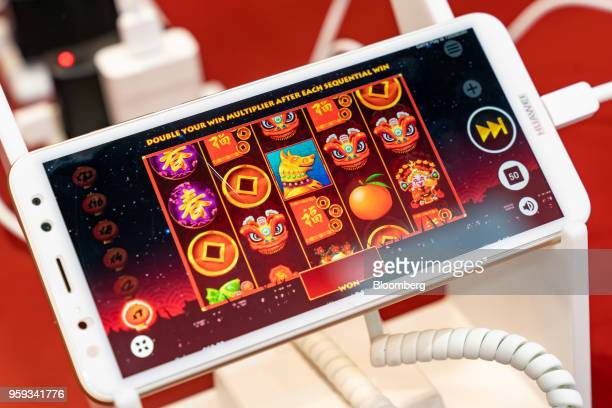 A game is displayed on a Huawei Technologies Co smartphone at the Global Gaming Expo Asia in Macau China on Wednesday May 16 2018 The expo runs...