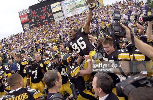 Game MVP and quarterback Drew Tate of the Iowa Hawkeyes celebrates with wide receiver Warren Halloway after Halloway caught the game-winning...