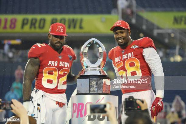 Game MVP honorees Delanie Walker of the Tennessee Titans and Von Miller of the Denver Broncos celebrate onstage after winning the NFL Pro Bowl...