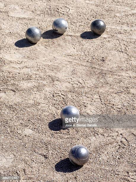 Game of boules in a park with ball on the floor