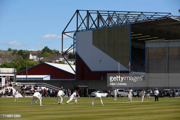 Game of cricket takes places outside the stadium prior to the Premier League match between Burnley FC and Arsenal FC at Turf Moor on May 12, 2019 in...