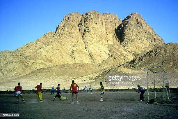 A game of football taking place at the foot of Mount Sinai a 2285 meters high mountain in the Sinai Peninsula of Egypt It was situated next to Mount...