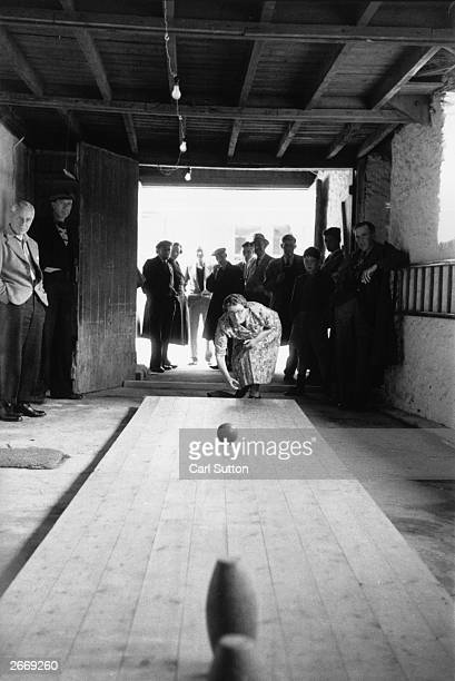 A game of skittles in progress in a village alley Original Publication Picture Post 7202 We are Murdering Our Countryside pub 1954