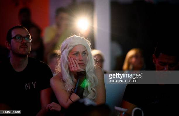 "Game of Thrones fan dressed up as Queen Daenerys awaits the start of HBO's ""Game of Thrones"" series finale at a viewing party at the Loft 51..."