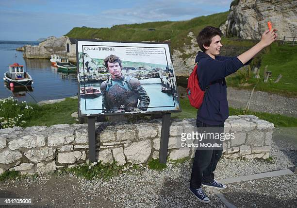 Game of Thrones fan takes a 'selfie' beside a plaque at Ballintoy Harbour on August 13 2015 in Belfast Northern Ireland According to recent audited...