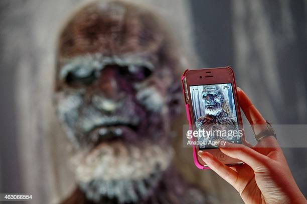 Game of Thrones fan taking pictures of a White Walker model figure at 'Game of Thrones The Exhibition' at the O2 in London England on February 09...