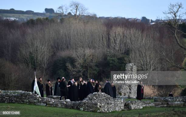Game of Thrones fans watch on as the reenactment of Saint Patrick's first landing in Ireland takes place at Inch Abbey on March 11 2018 in...