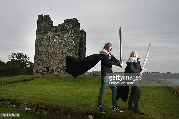 Game of Thrones tourists Kevin Recher and Kathrin Trattner from Austria pose for photographs at Audleys Castle on August 13, 2015 in Belfast,...