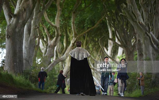 Game of Thrones tourists take photographs of one another as they visit a beech tree lined road known locally as The Dark Hedges on August 13 2015 in...