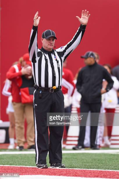 Game official Head Linesman referee Michael Dolce signaling a touchdown during a college football game between the Wisconsin Badgers and the Indiana...