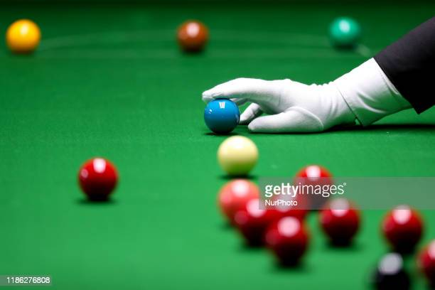 Game official inspects the placement of the ball in the Snooker Double competition for the 30th SEA Games held in Manila on December 3, 2019.