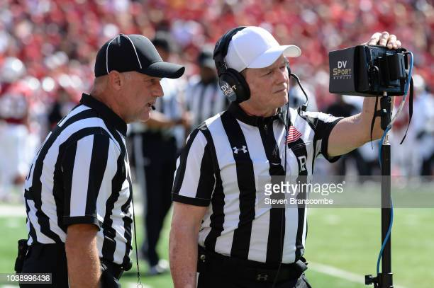 Game officials looks at a video review monitor during the game between the Nebraska Cornhuskers and the Troy Trojans at Memorial Stadium on September...