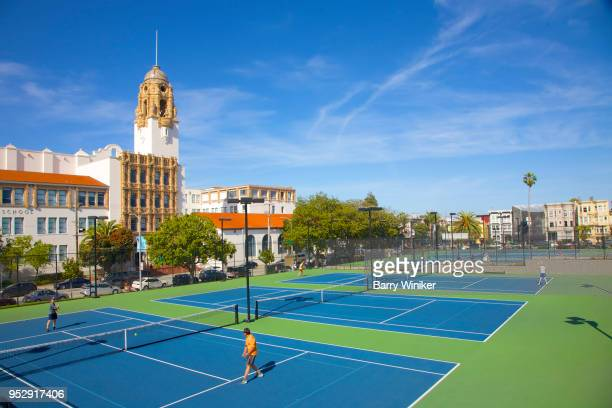 game, public New blue and green tennis courts in Mission Dolores Park