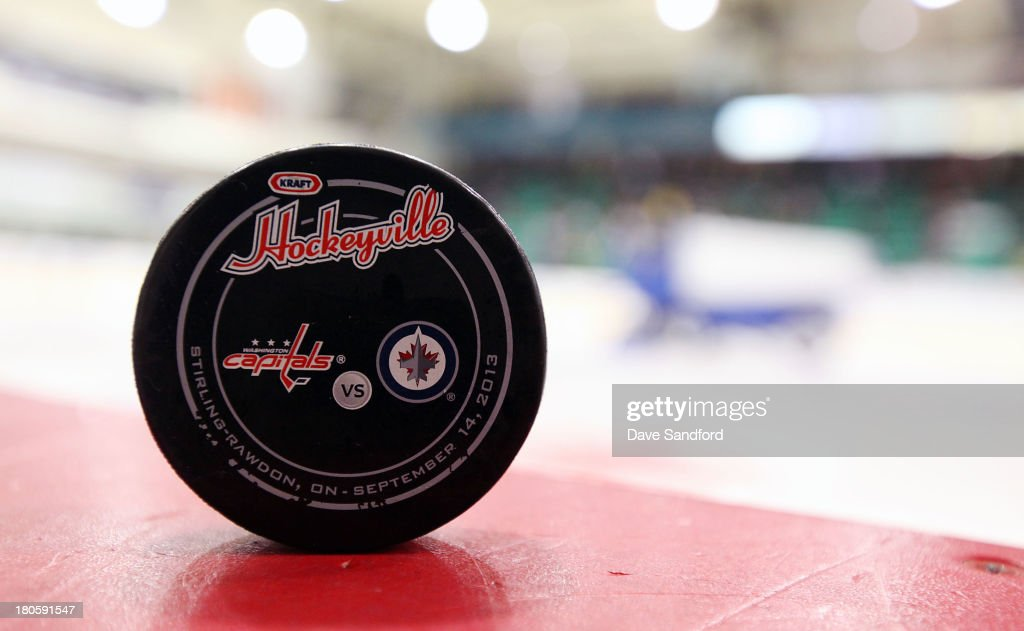 A game puck sits on the boards prior to the Washington Capitals facing the Winnipeg Jets during Kraft Hockeyville Day 2 at Yardman Arena on September 14, 2013 in Belleville, Ontario, Canada.