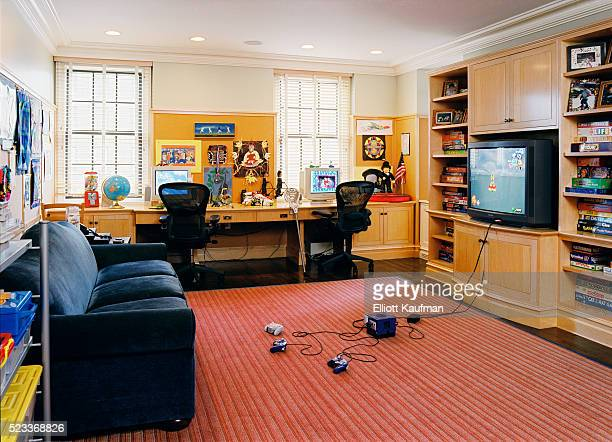 game room with built-in desks and cabinetry - man cave stock photos and pictures