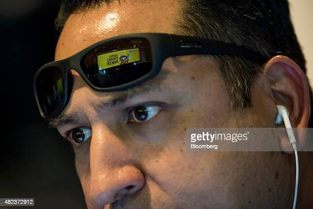 A game screen is reflected in an attendees' sunglasses as he participates in a hackathon creating new levels for Nintendo Co Super Mario Maker video...