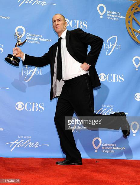 Game show host Ben Bailey poses with the Outstanding Game Show Host award in the press room at the 38th Annual Daytime Entertainment Emmy Awards held...