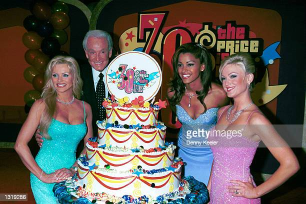 Game show host Bob Barker poses with his new modeling team Nikki Ziering Claudia Jordan and Heather Kozar at CBS Studios to celebrate Barker''s 30th...