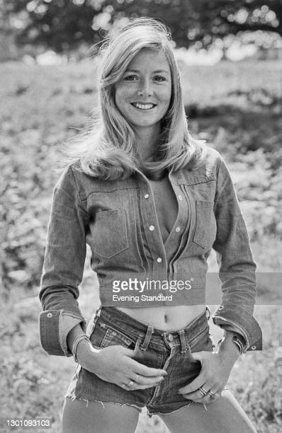 Game show host Canasta wearing denim shorts and a jacket, UK, 13th August 1973.