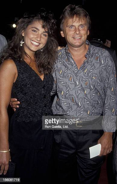 Game Show Host Pat Sajak and wife Lesly Brown attending the premiere of 'Mr Saturday Night' on September 22 1992 at Mann Chinese Theater in Hollywood...