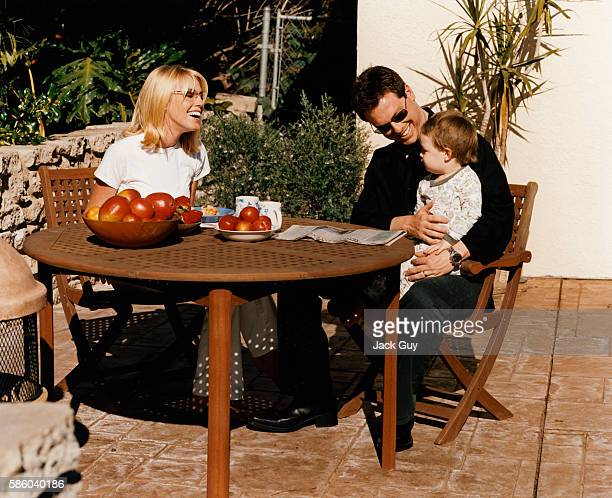 Game show host Todd Newton and family are photographed for InTouch Weekly in 2003 at home in Los Angeles California PUBLISHED IMAGE