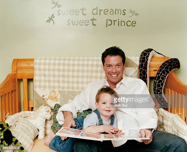 Game show host Todd Newton is photographed with son Mason for InTouch Weekly in 2003 at home in Los Angeles California PUBLISHED IMAGE