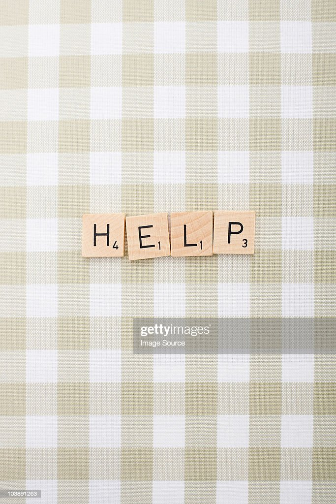Game tile letters spelling help : Stock Photo