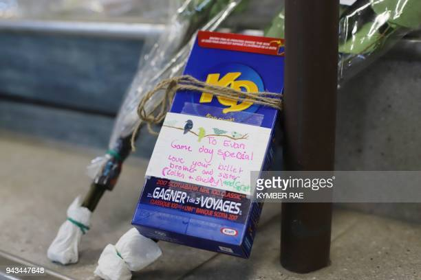 A game video is left in a makeshift memorial at the Humboldt Uniplex in Humboldt Canada on April 8 2018 Canadian Prime Minister Justin Trudeau will...