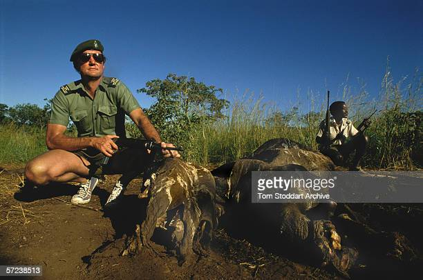 A game warden displays a rhino carcass from an animal which has been killed by poachers in the Mana Pools game reserve near the Zambezi River Zimbabwe
