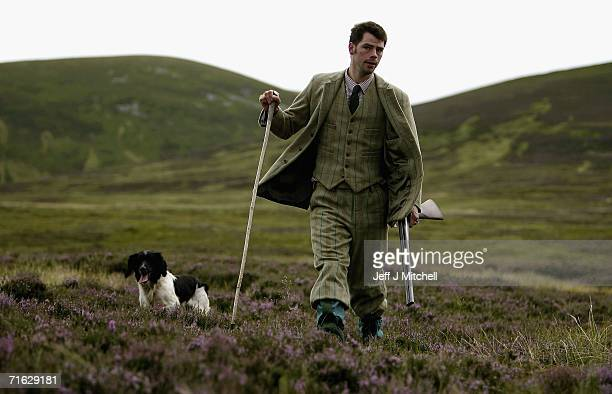 Gamekeeper Andrew Drummond walks with his springer spaniel on Drumochter Moore on the Milton Estate August on August 11 2006 Dalwhinnie in...