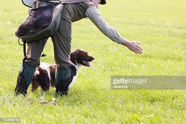 gamekeeper with his dog - springer spaniel stock pictures, royalty-free photos & images