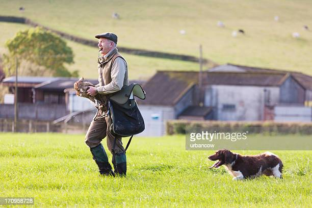 gamekeeper working with his dog - whistle stock pictures, royalty-free photos & images
