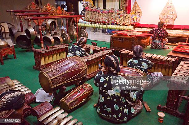 Gamelan traditional percussion orchestra accompanying a Wayang Kulit show in a Museum in Yogyakarta . Gamelan music is very popular in Bali too....