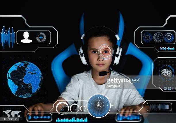 gamer boy with virtual hud - hud graphical user interface stock photos and pictures