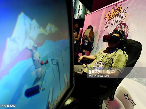 A gamer experiences the virtual reality Rabbids game simulator at the Ubisoft display at the opening day of the Electronic Entertainment Expo known...