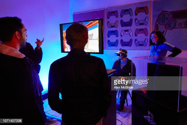 A gamer gets his photo taken at an Amazon Black Friday popup shop on November 23 2018 in London England Shoppers are looking to find bargains at the...
