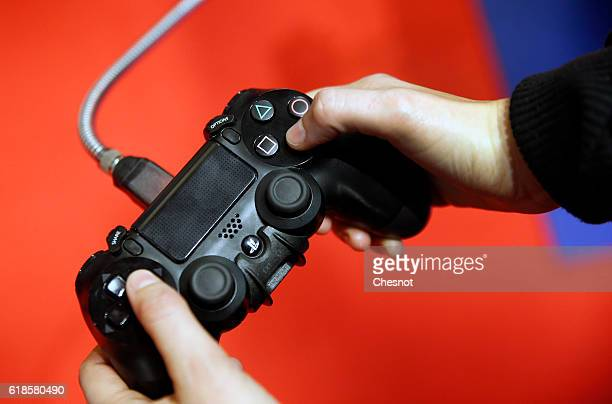 A gamer plays a video game on Sony PlayStation game console PS4 during the Paris Games Weekon October 27 2016 in Paris France Paris Games Week is an...
