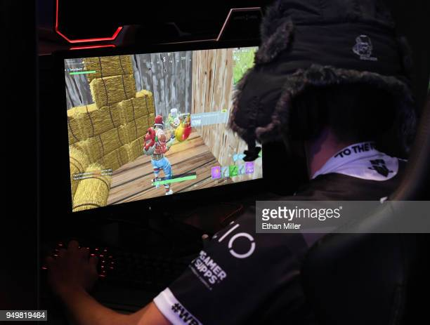 "Gamer plays ""Fortnite"" against Twitch streamer and professional gamer Tyler ""Ninja"" Blevins during Ninja Vegas '18 at Esports Arena Las Vegas at..."