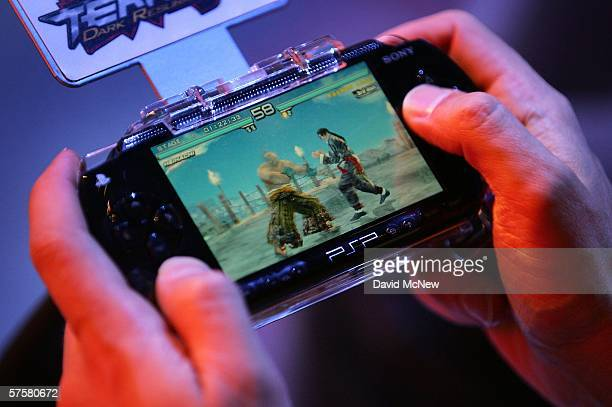 A gamer plays on a PlayStation Portable device on day one of the Entertainment Software Association's 2006 Electronic Entertainment Expo at the Los...