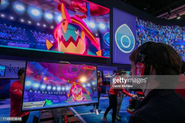 A gamer plays Pokémon Sword and Pokémon Shield at E3 2019 at the Los Angeles Convention Center on June 12 2019 in Los Angeles California The...