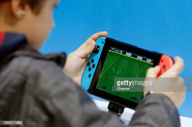 A gamer plays the video game 'Fifa 19' developed and published by Electronic Arts on a Nintendo Switch games console during the 'Paris Games Week' on...