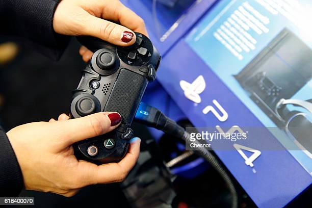 A gamer plays the video game 'For Honor' published by Ubisoft game editor on Sony PlayStation game console PS4 during the Paris Games Weekon October...