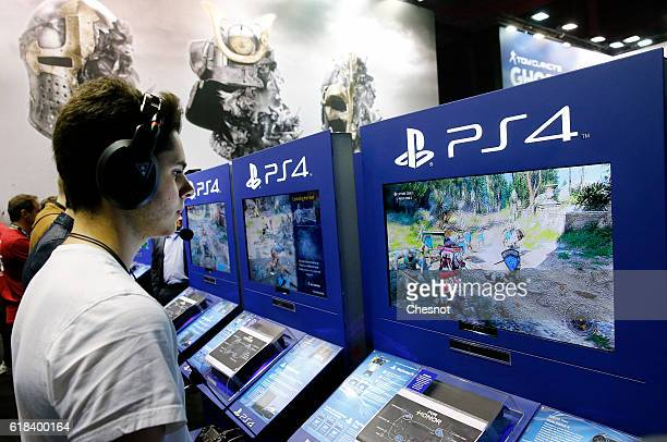 A gamer plays the video game 'For Honor' published by Ubisoft games editor on Sony PlayStation game console PS4 during the 'Paris Games Week'on...