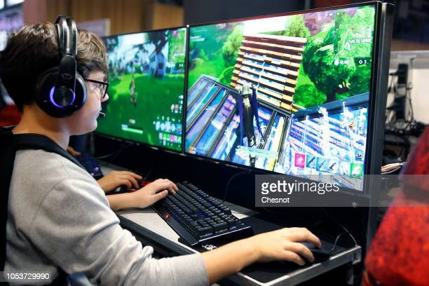 A gamer plays the video game 'Fortnite Battle Royale' developed by Epic Games during the 'Paris Games Week' on October 26 2018 in Paris France 'Paris...